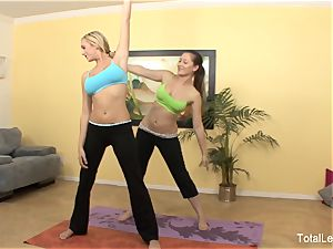 uber-cute yoga femmes Brett and Dani gusto each other