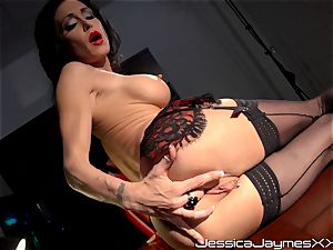 ultra-kinky brown-haired Jessica Jaymes fingers her tastey twat pie in her office