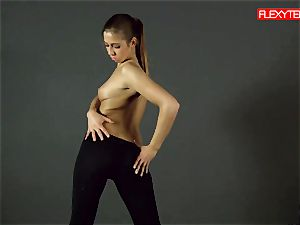 brown-haired gymnast displaying of her booty