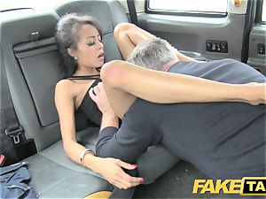 faux taxi stunning youthful dark-hued girl in gimp outfit