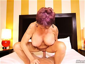 huge-titted Russian GILF bursts all over manstick