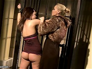 Kathia Nobili in fur covered jacket tormenting a red-hot stunner