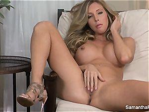 busty blonde Samantha Saint thumbs her vagina