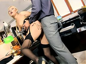 assistant Donna penetrated in dark-hued seamed tights